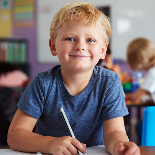 Close-up of boy in classroom